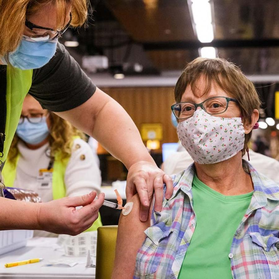 Photo of woman being vaccinated